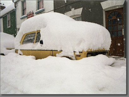 The snow piled up on top of a car in Wouldham High Street, Kent